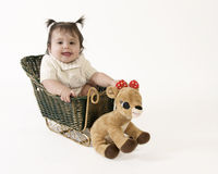 Baby in christmas sleigh Royalty Free Stock Photography