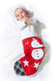 Baby in a christmas sock. Stock Images