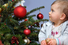 Baby By Christmas Tree Stock Image - Image: 12156091