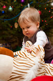 Baby at Christmas tree Stock Photos