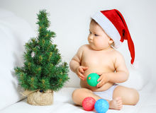 Baby with christmas tree Royalty Free Stock Photo