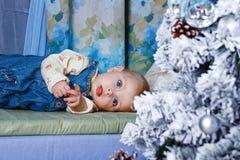 Baby and Christmas Tree Stock Image