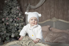 Baby and Christmas tree. Smiling baby and Christmas tree Royalty Free Stock Images