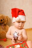Baby in Christmtas hat royalty free stock photography