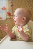 Baby is clapping hands royalty free stock photo