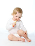 Baby cleaning one's teeth Royalty Free Stock Images