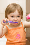 Baby cleaning teeth Stock Photo