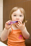 Baby cleaning teeth Royalty Free Stock Images