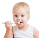 Baby cleaning teeth and smiling Stock Photography