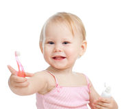 Baby cleaning teeth and smiling, isolated on white Stock Images
