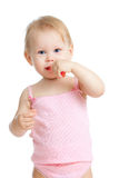 Baby cleaning teeth and smiling, isolated on white Royalty Free Stock Photos
