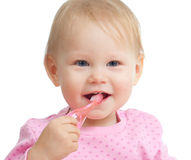 Baby cleaning teeth and smiling, isolated on white Royalty Free Stock Image
