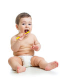 Baby cleaning teeth and smiling Royalty Free Stock Image