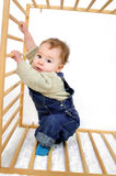 Baby while climbing Royalty Free Stock Image