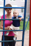 Baby climbing step ladder Stock Images