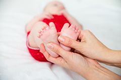 Baby in a clinic. A portrait of a baby in a clinic royalty free stock photo