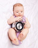 Baby with clock Stock Photo
