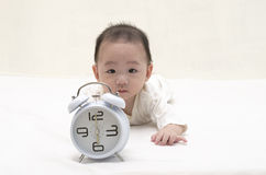Baby with clock Stock Photography