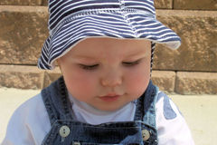 Baby close-up. Image of a baby sitting outside royalty free stock image