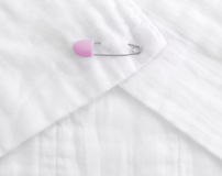 Baby cloth diaper with a Pink pin Stock Photo