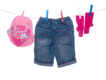 Baby clothes. Hang on clothesline stock photos