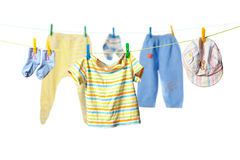 Baby clothes. Drying on a rope isolated on white background royalty free stock image