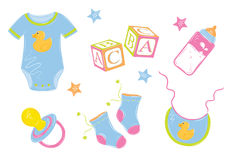 Baby clothes. With a bottle nipple cubes in bright saturated blue-violet range Stock Photo