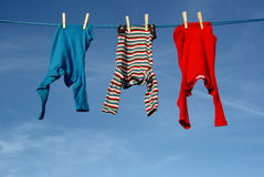 Baby clothes. At a clothesline hanging in the sun royalty free stock image