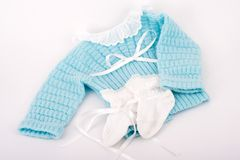 Baby clothes. Blue and white royalty free stock photo