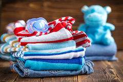 Baby clothes. With booties on a wooden table royalty free stock photography