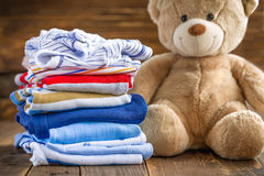 Baby clothes. Baby boy clothes with toys stock images