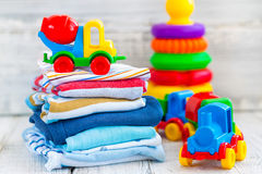 Baby clothes. Baby boy clothes with toys stock photo