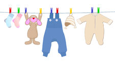 Baby clothes and bunny Royalty Free Stock Images