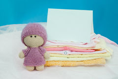The baby clothes with card Royalty Free Stock Image