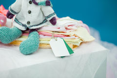 The baby clothes with card Stock Image