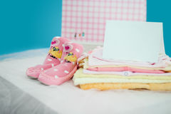 The baby clothes with card Stock Photos