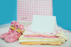 The baby clothes with card Stock Photography
