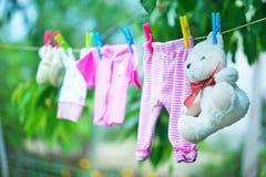 Baby clothes. Clear baby linnen in garden royalty free stock photos