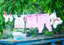 Baby clothes. Clear baby linnen in garden Stock Photos