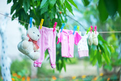 Baby clothes. Clear baby linnen in garden stock image