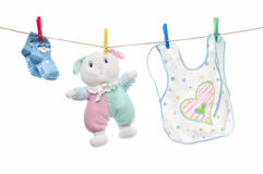 Baby clothes on clothesline Stock Images