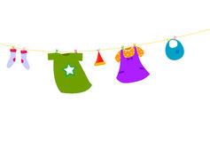 Baby clothes on a clothesline Stock Image