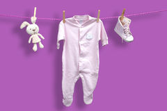 Baby clothes on the clothesline Royalty Free Stock Photo