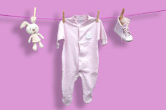 Baby clothes on the clothesline Royalty Free Stock Photography