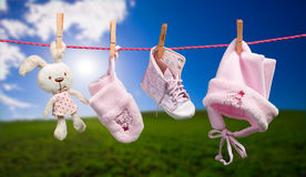 Baby clothes on the clothesline in outdoor Stock Photo