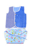 Baby clothes. Colorful baby clothes on white background royalty free stock photography