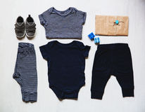 Baby clothes, concept of child fashion. Flat lay children's clothing and accessories. Baby template background with copy space. Top view fashion trendy look of stock photo
