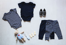 Baby clothes, concept of child fashion. Flat lay children's clothing and accessories. Baby template background with copy space. Top view fashion trendy look of stock images