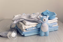 Baby clothes with diapers are stacked Royalty Free Stock Photo