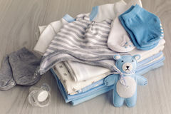 Baby clothes with diapers are stacked Stock Photography